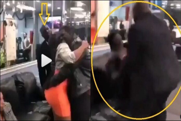 A Man Receive Beatings for Over Hugging Another Persons Wife - Watch Video